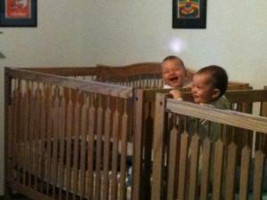 Twins Standing in Cribs laughing 10246497_677891438499_5342250590964517992_n