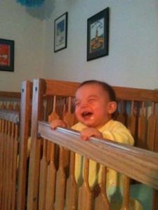 Zachary Standing in Crib Laughing